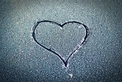 Love. The heart drawn on a frozen glass royalty free stock image