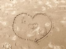 Love heart drawn on sand stock images