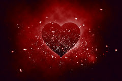 Love heart. Explosion with dust particles flying around Stock Images