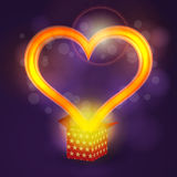 Love heart flying from present box on bokeh background Royalty Free Stock Images