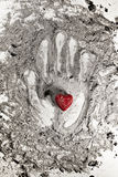 Love heart on hand print in ash royalty free stock image