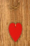 Love heart hanging on wooden texture background, valentines day Royalty Free Stock Images