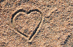 Love heart icon in the sand Stock Photo