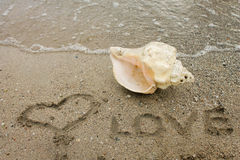 Love, heart - inscription on the sand Royalty Free Stock Photos