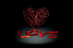 Love. A heart isolated on a black background Royalty Free Stock Images