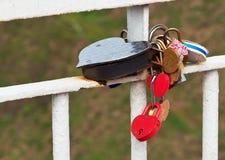 Love heart locks with on white metal bridge Stock Photos