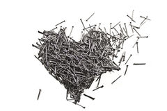 Love heart made of iron nails. Love heart made of shiny iron nails Royalty Free Stock Photography