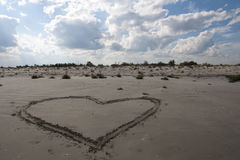 Love. Heart made in sand at sunny summer day Royalty Free Stock Photo