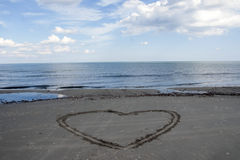 Love. Heart made in sand at sunny summer day Royalty Free Stock Images