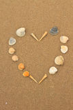 Love heart made of shells on beach Royalty Free Stock Images