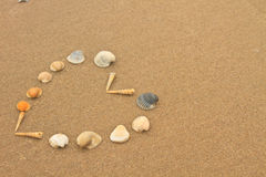 Love heart made of shells on beach Stock Photos