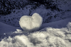 Love heart made of snow on top of the hill Stock Photos