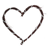 Love heart made of twigs. A love heart made of twigs, bound by a blue ribband Stock Photography