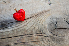 Love heart melting on a wooden surface Stock Images