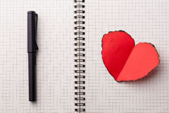 Love heart on notebook Stock Images