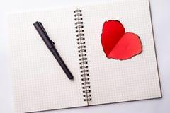 Love heart on notebook Stock Photo