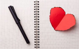 Love heart on notebook Royalty Free Stock Photo