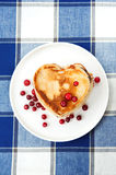 Love heart pancakes with cranberries on porcelain plate. Closeup Royalty Free Stock Image