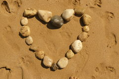Love heart from pebbles on a beach Stock Photo