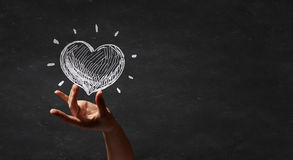 Love heart. Person hand and chalk drawing of heart Royalty Free Stock Photos