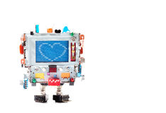 Love heart and retro robot with monitor head, colorful capacitor resistor electronic elements. Error warning message on. Blue screen. macro copy space stock image