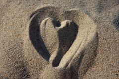 Love heart on sand. Overhead view of love heart drawn on sandy beach Royalty Free Stock Images