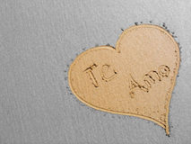 Love heart on the sand. Heart with the words Te Amo drawn in the sand Royalty Free Stock Images