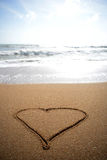 Love heart in the sand. Stock Photos