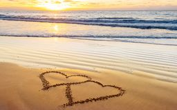 Love, heart on sea beach. Couple hearts on sea beach. Valentine day and love concept royalty free stock images