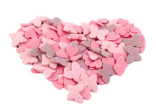 Love heart shape formed with sugar items isolated Stock Images