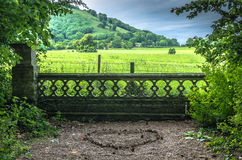 Love heart shape on the ground with a countryside view royalty free stock photo