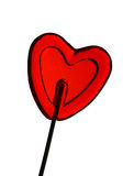 Love - Heart shape lollipop. Red sugar candy on a stick in the form of heart on a white background Stock Image