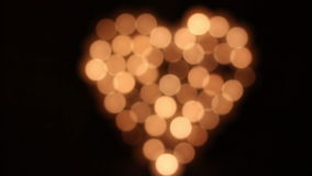 Love-Heart shape made of candles stock footage