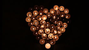 Love-Heart shape made of candles. Heart shape made of candles stock video