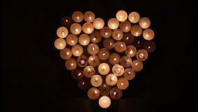 Love-Heart shape made of candles. Heart shape made of candles stock video footage