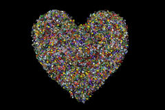 Love heart shaped from beads on black background Stock Photography