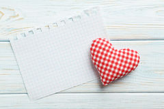 Love heart and sheet of blank paper Stock Image