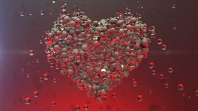 Love heart.Shining Glass balls create valentines heart and exploding heart particles. Good for love story intro and wedding video. Valentines day present and stock video