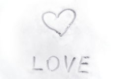 Love heart sign writen on the snow Stock Photography