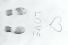 Love heart sign writen on the snow Royalty Free Stock Images