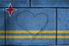 Love heart sing on wall with blending  Aruba flag Royalty Free Stock Photography