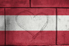 Love heart sing on wall with blending  Austria flag Royalty Free Stock Photos