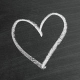 Love heart symbol. On a blackboard royalty free stock images
