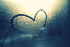 Love Heart Symbol On Wet And Frozen Window Background