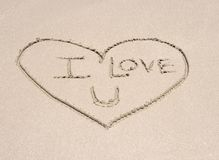 Love heart symbol in sand on tropical beach Stock Image