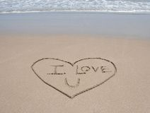Love heart symbol in sand on tropical beach Royalty Free Stock Photography