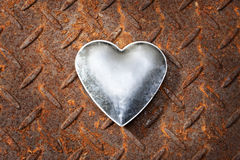 Love Heart Valentine Background. A metal heart on a rusty metal background Royalty Free Stock Images
