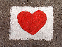 Love heart in white rectangle. Red heart painted on the road stock photo