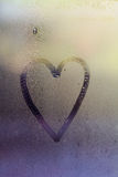Love heart on window. Love heart drawn in condensation on window Royalty Free Stock Image