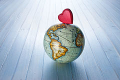 Love Heart World Globe Hope Background. A world globe with a red heart on a blue background stock images